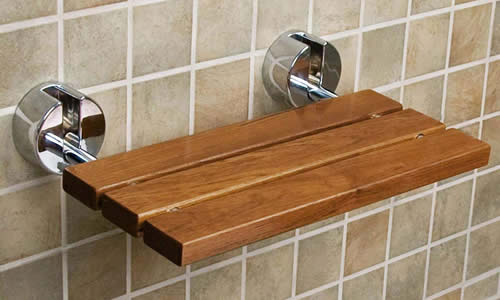Wall mounted folding teak shower bench
